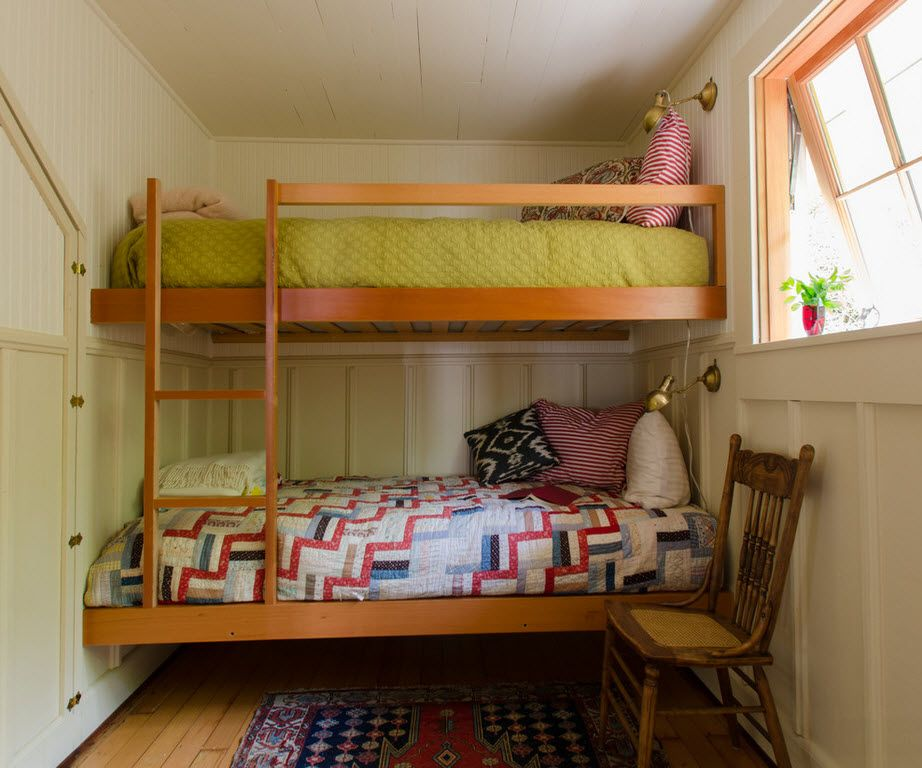Small kids' room with wooden bunk bed and ladder