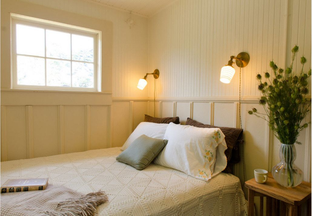 Classic styled room with lower wainscoting and large bed