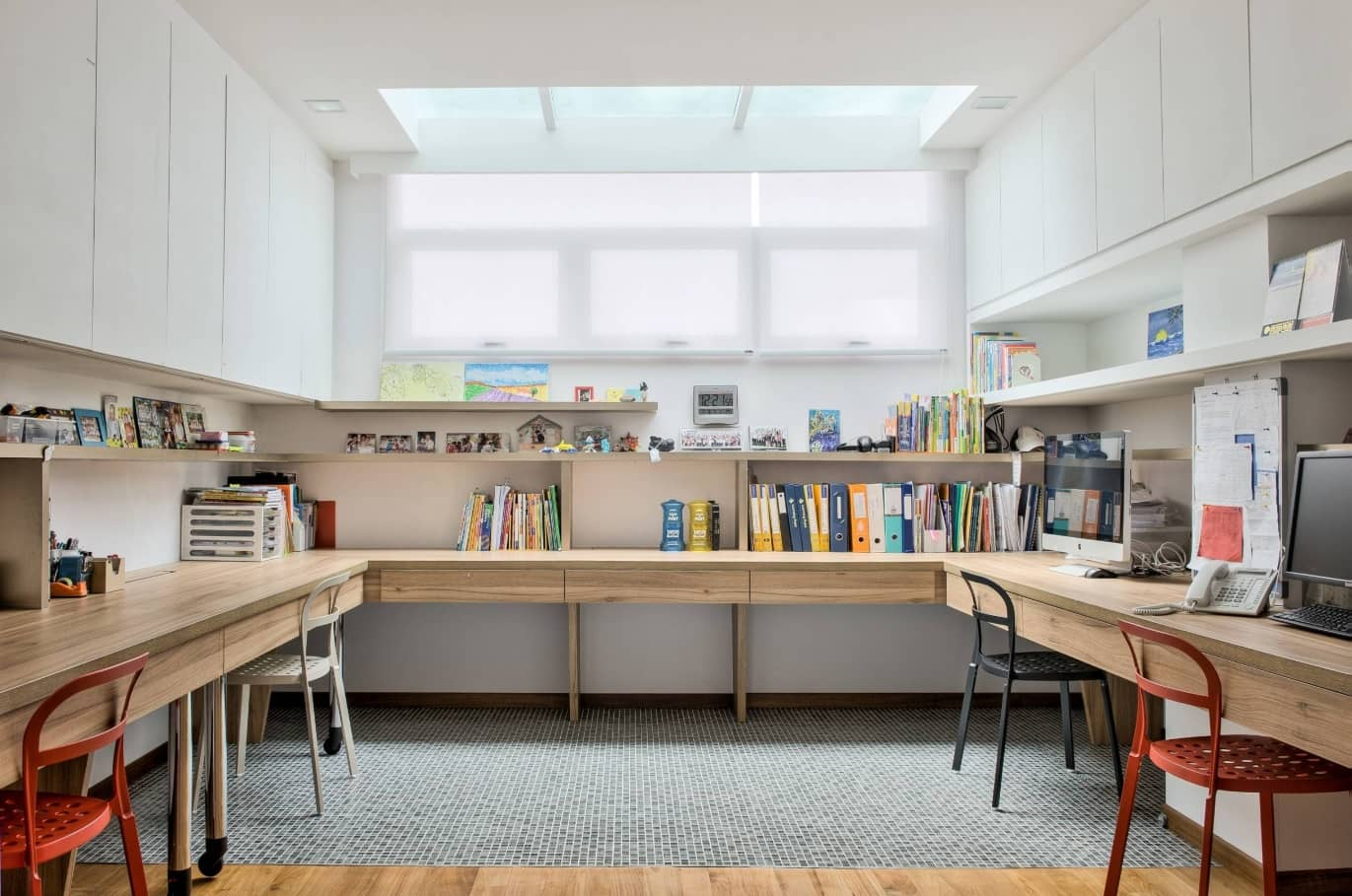 Study Room Design and Finishing Trends with Photos. White designed room with perimeter desk and full of personal things
