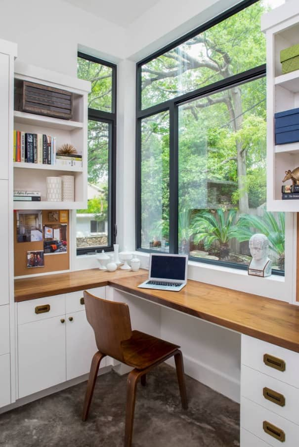 Panoramic windows and window sill desk for studies in the private house among nature