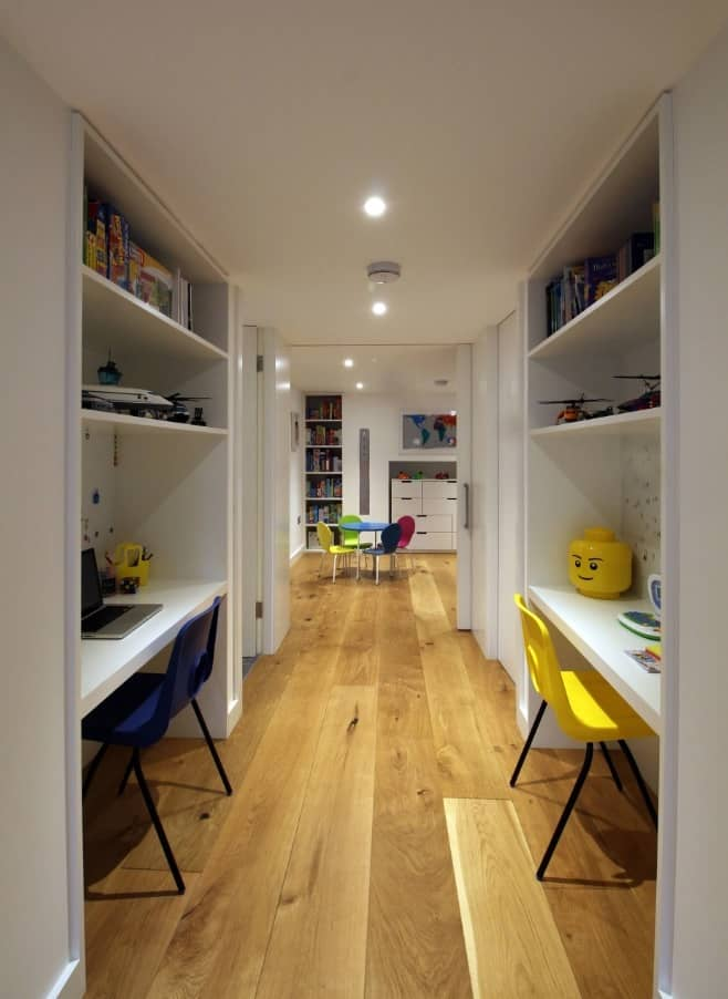 Narrow modern designed study room with white furniture