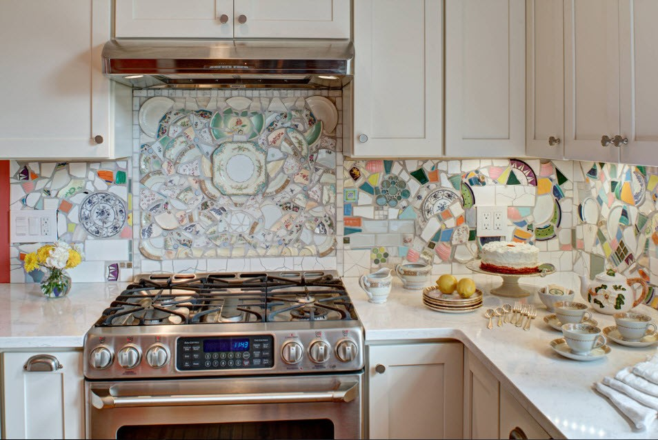 Classic functional kitchen with solid composition of furniture and colorful tiled backsplash