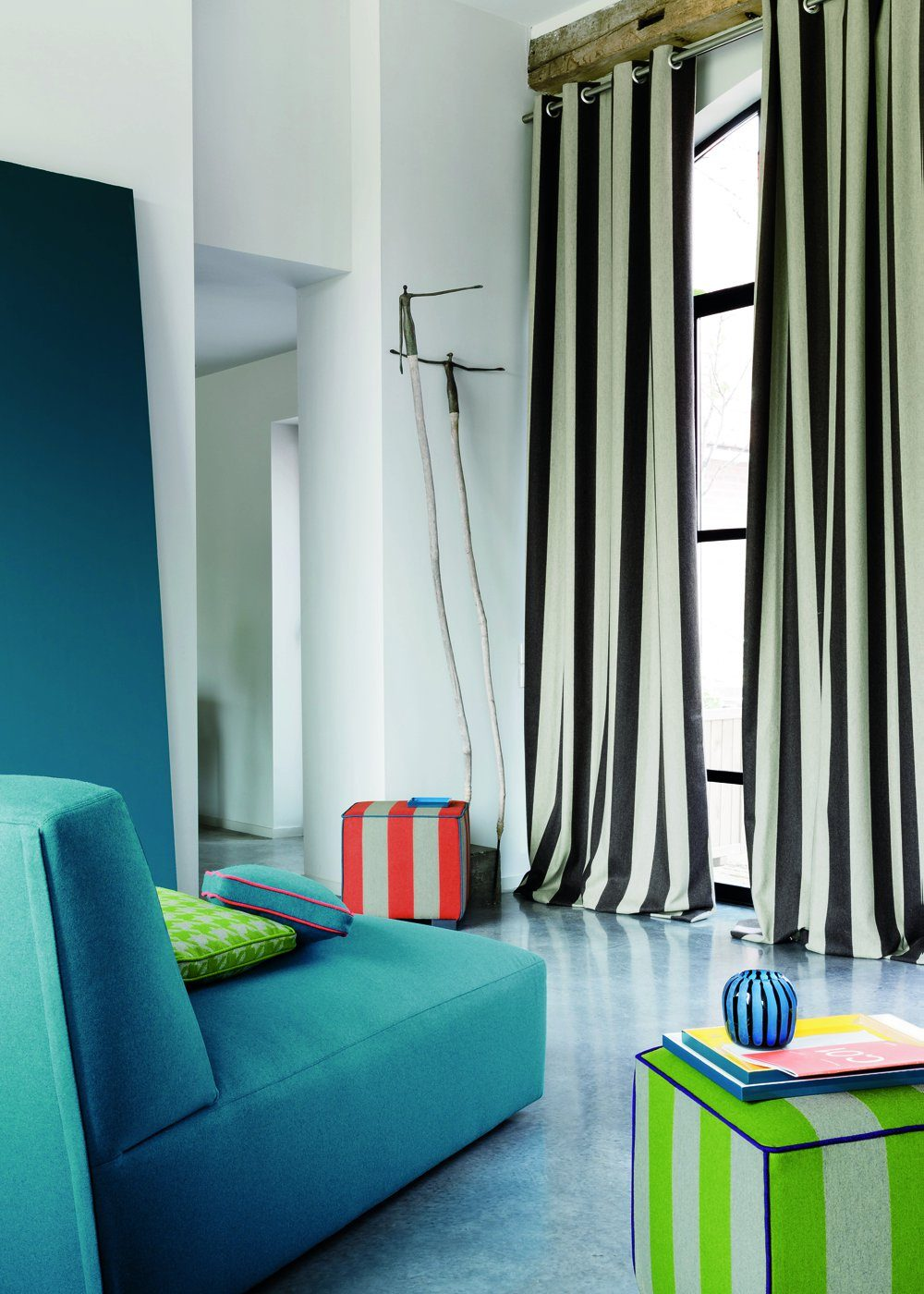 Vertical stripes on the high curtains for modern Fusion designed bedroom