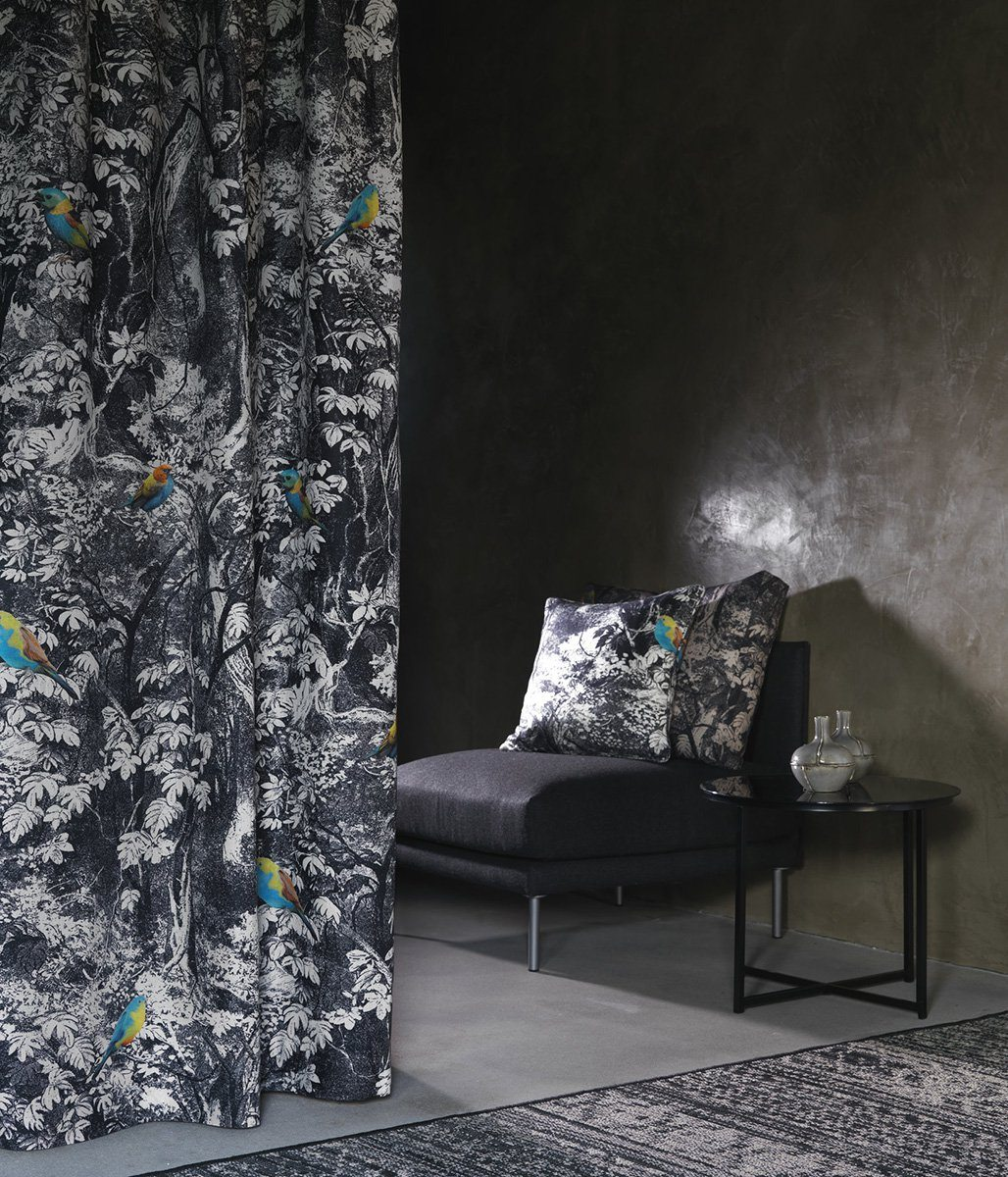 Dark styled bedroom with unusual pattern of the curtains