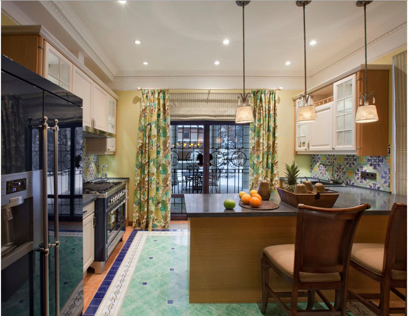 Colorful curtains and green floor tile for Mediterranean styled kitchen