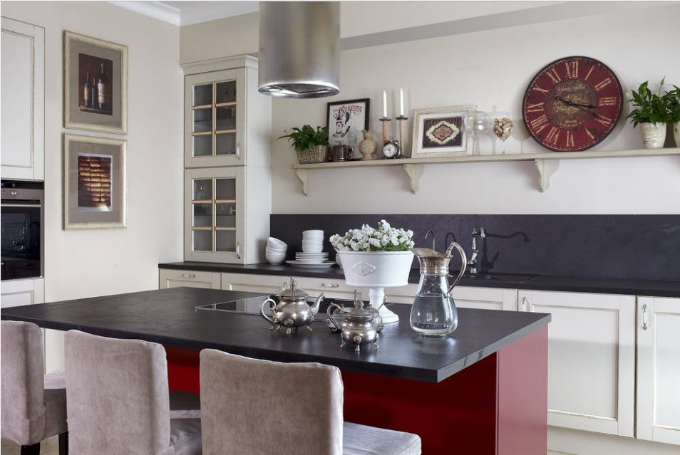 Red kitchen island with black top looks accentual in Casual interior