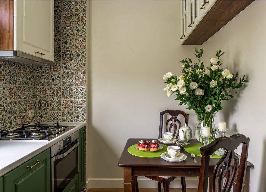 Small kitchen with dining room and colorful tiled splashback