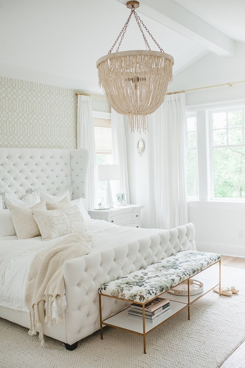 Neat white Classic bedroom with gilded crystal chandelier