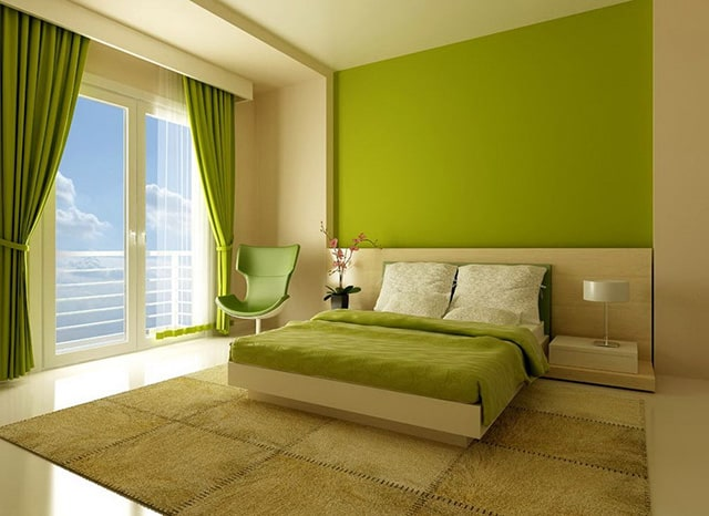 Green colored walls, armchair and blanket