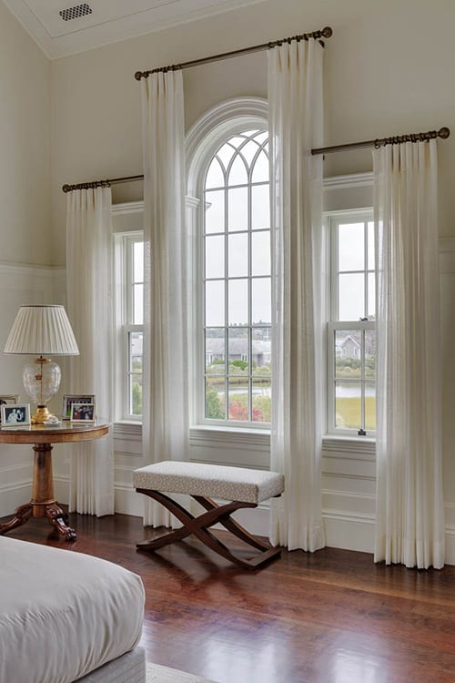 Classic styled bedroom with arched window