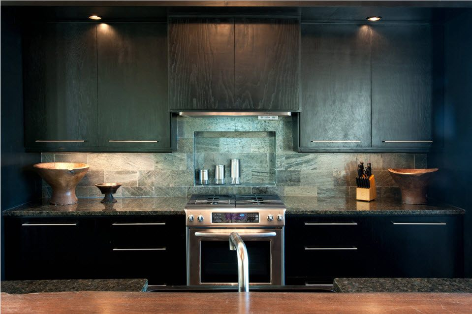 Dark colored kitchen in Modern style with textured facades of the top tier and glossy black bottom tier