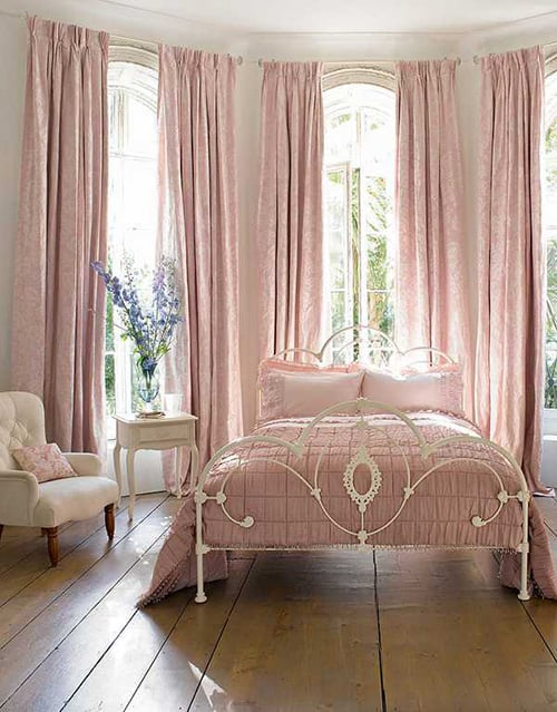 Peach colored bedroom with high curtains