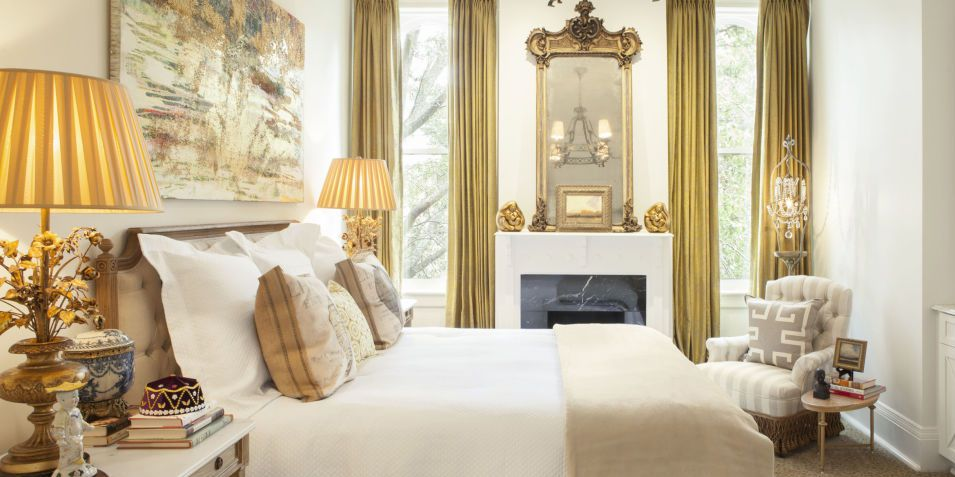 Royal design of the bedroom with gild curtains
