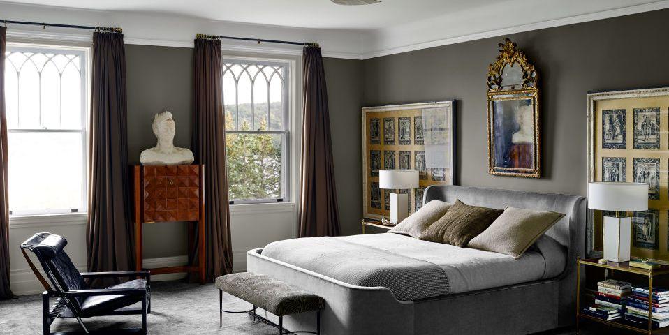 Gray beroom walls and dark curtains