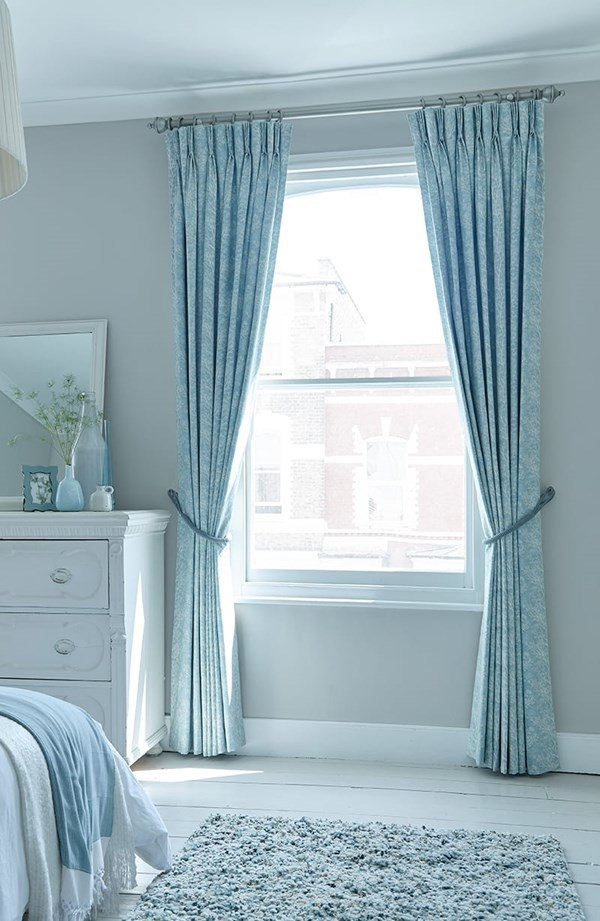 Neat gray walls and azure curtains
