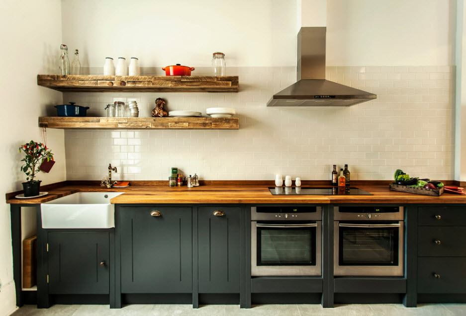 Rural design of the gray colored kitchen with black lower tier of fruniture