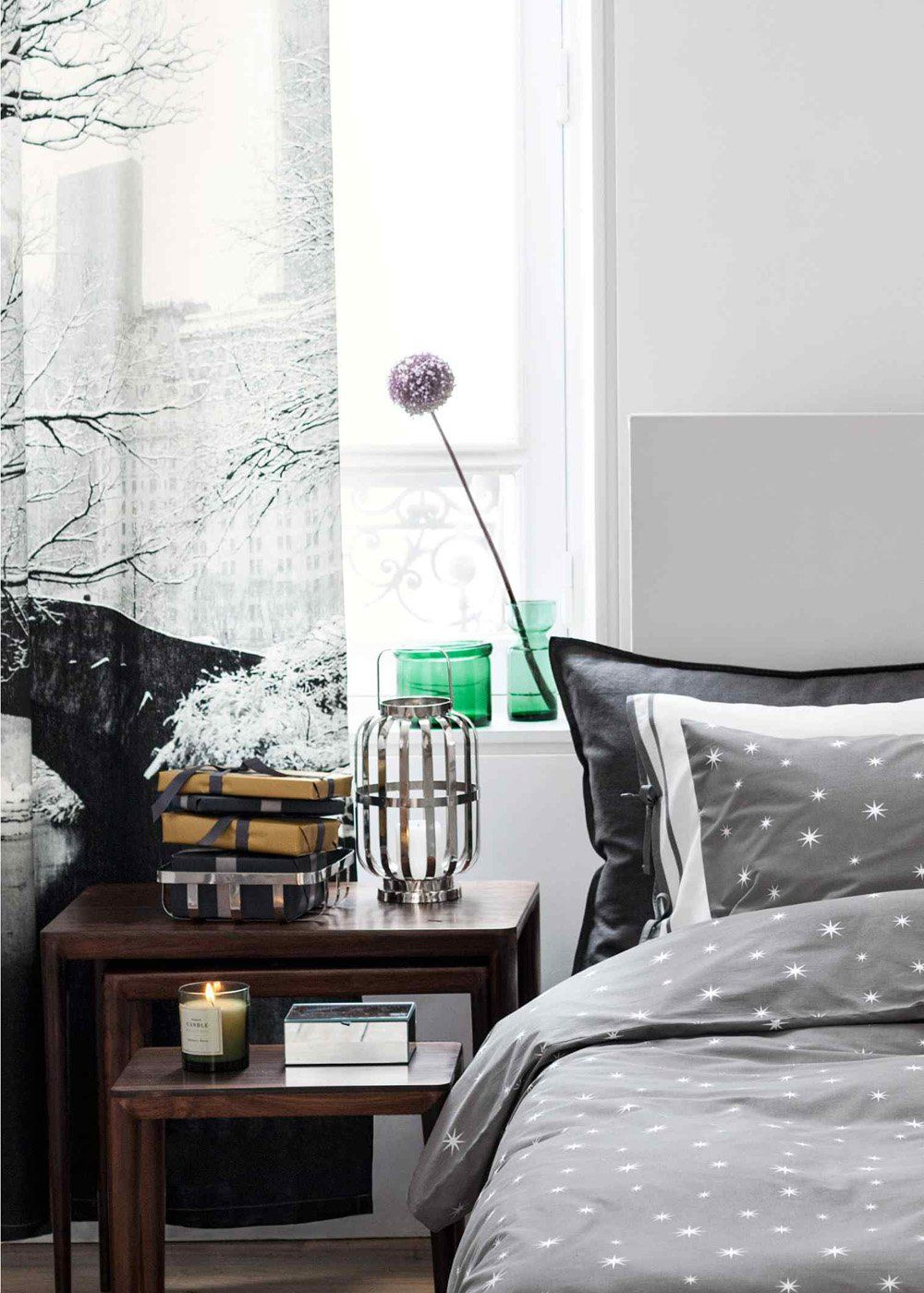 White and light gray color scheme for the modern bedroom with tulle on the window