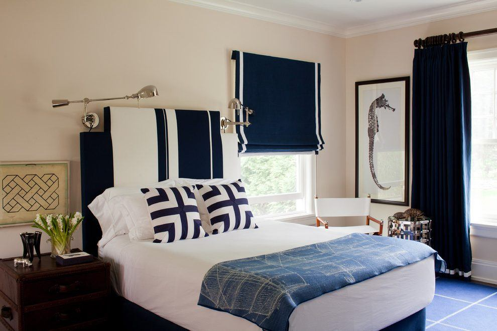 Pastel colored bedroom with blue roller blinds