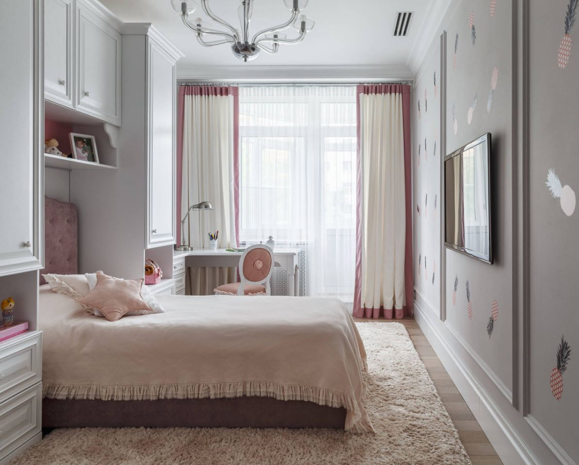 White casual interior of the bedroom with panel TV and white curtains