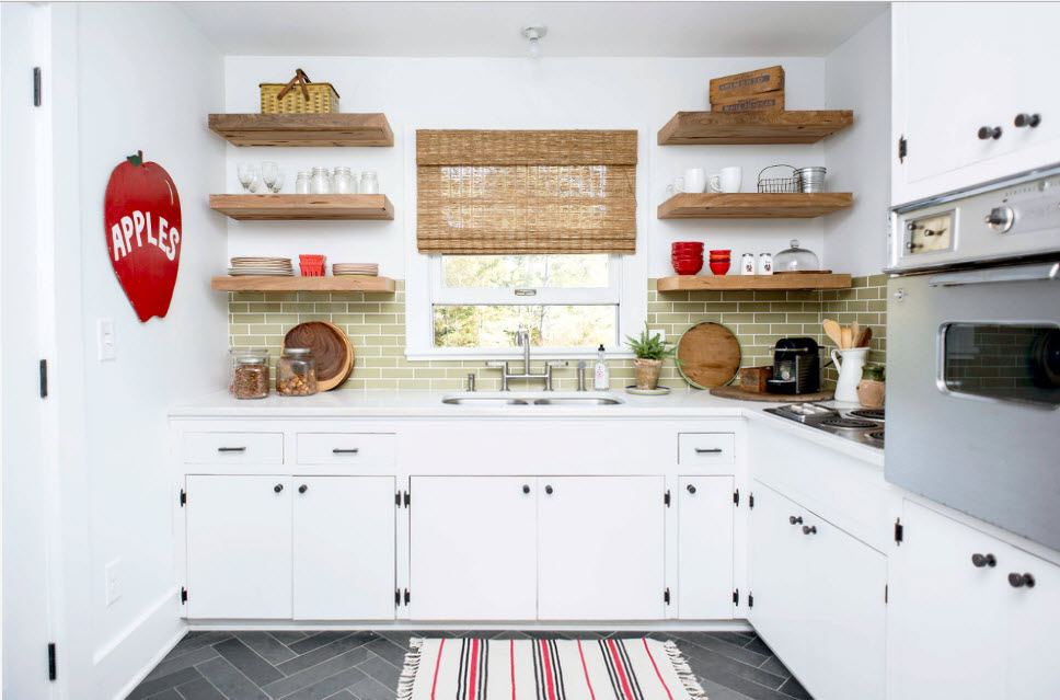 White designed casual kitchen with open shelves and monolithic bottom tier