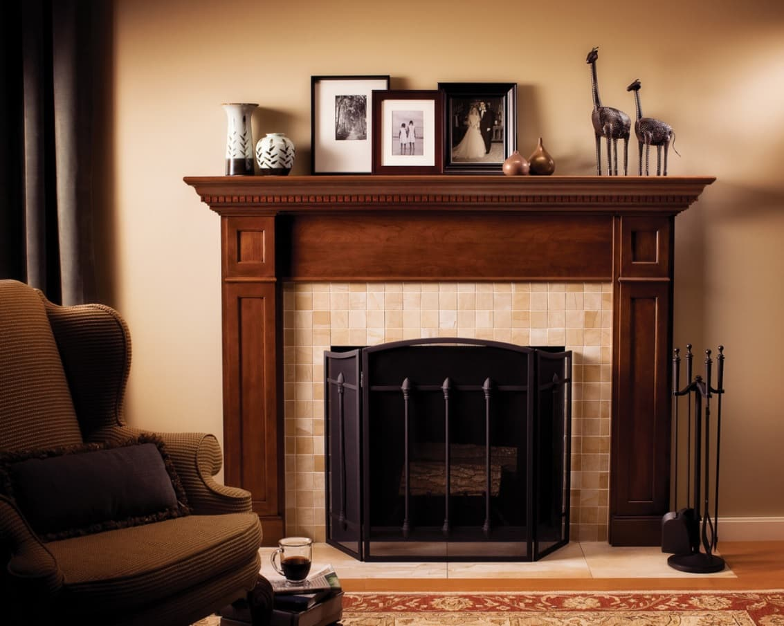 4 Reasons To Add A Fireplace To Your Living Room. Fireplace with the wooden mantelshelf and a fence