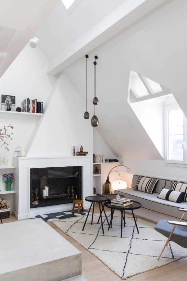 4 Reasons To Add A Fireplace To Your Living Room. White designed loft living room with large fireplace as a fical point