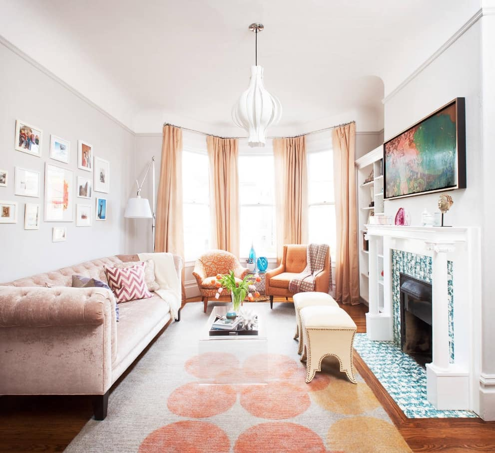 4 Reasons To Add A Fireplace To Your Living Room. Neat Classic room design with pink rug and Electric fireplace