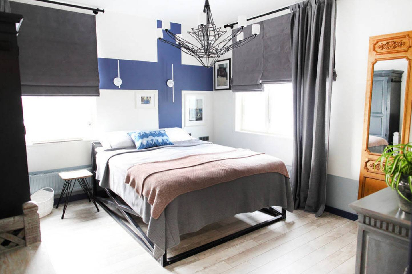 Bedroom Curtains: Full Guide on How to Decorate the Windows. Casual room with large Finnish flag at the wall