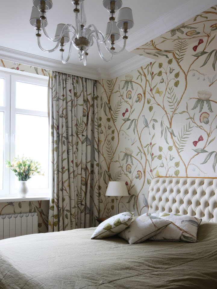Intermixing patterns on the wallpaper and curtains in Classic decorated bedroom