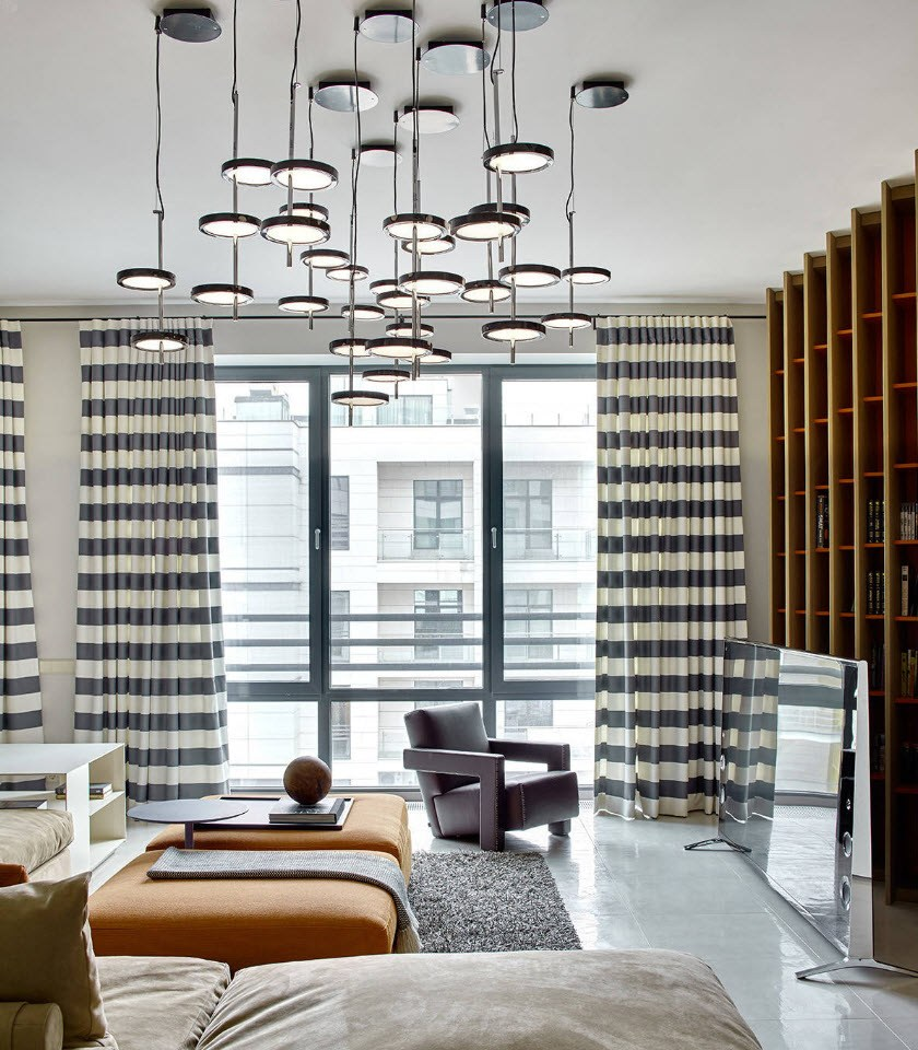 Bedroom Curtains: Full Guide on How to Decorate the Windows. White ceiling with myriads of lighting fixtures, striped curtains adn glossy floor for spectacular casual atmosphere