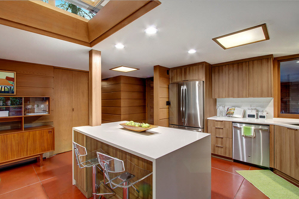 Original Country House Design in Red Color. White plastic coated island and the wooden designed kitchen