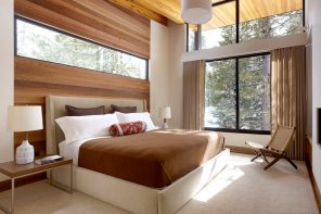 Window Design in the Bedroom for Ultimate Coziness and Comfort. Modern interior of the forest cottage with panoramic windows and wooden trimming