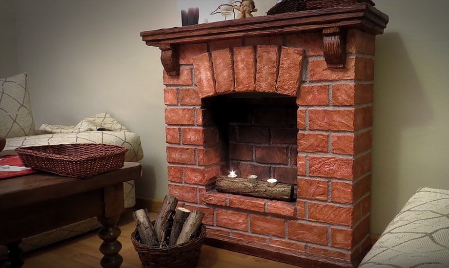 Brickwork imitating fireplace with mantelshelf