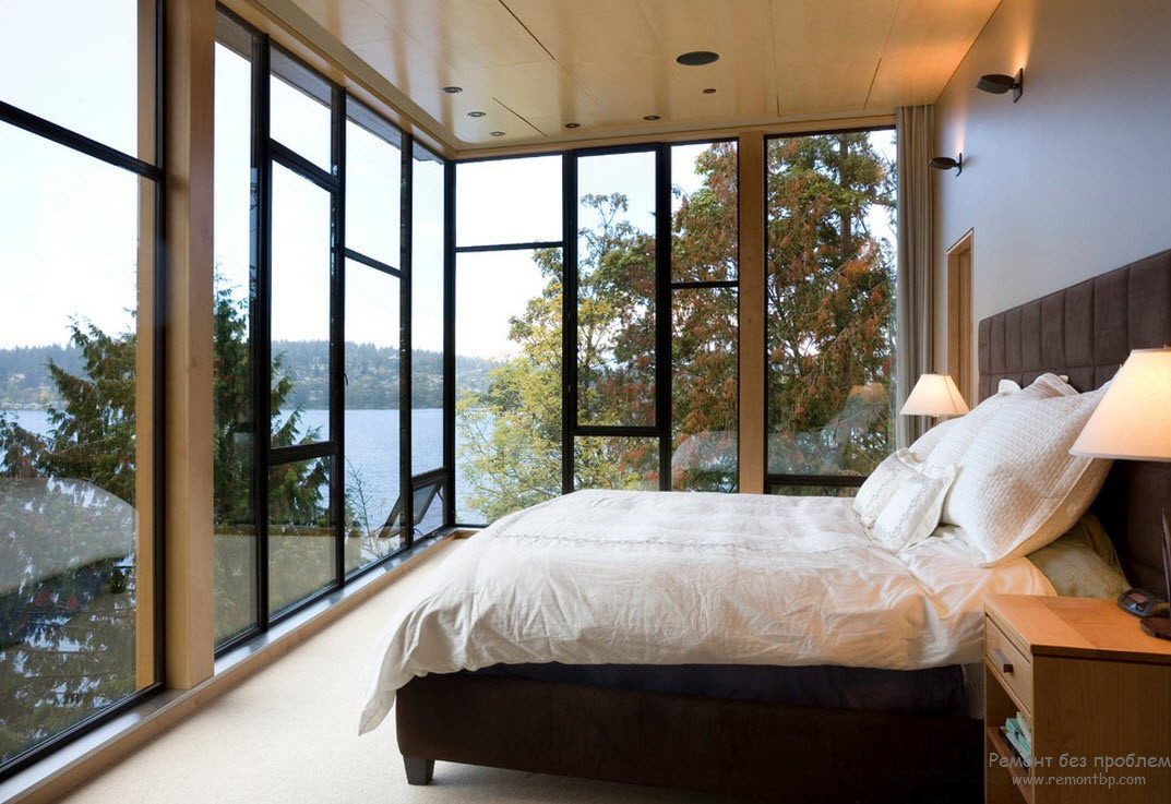 Window Design in the Bedroom for Ultimate Coziness and Comfort. Panoramic windows on black metal frame for ultramodern room