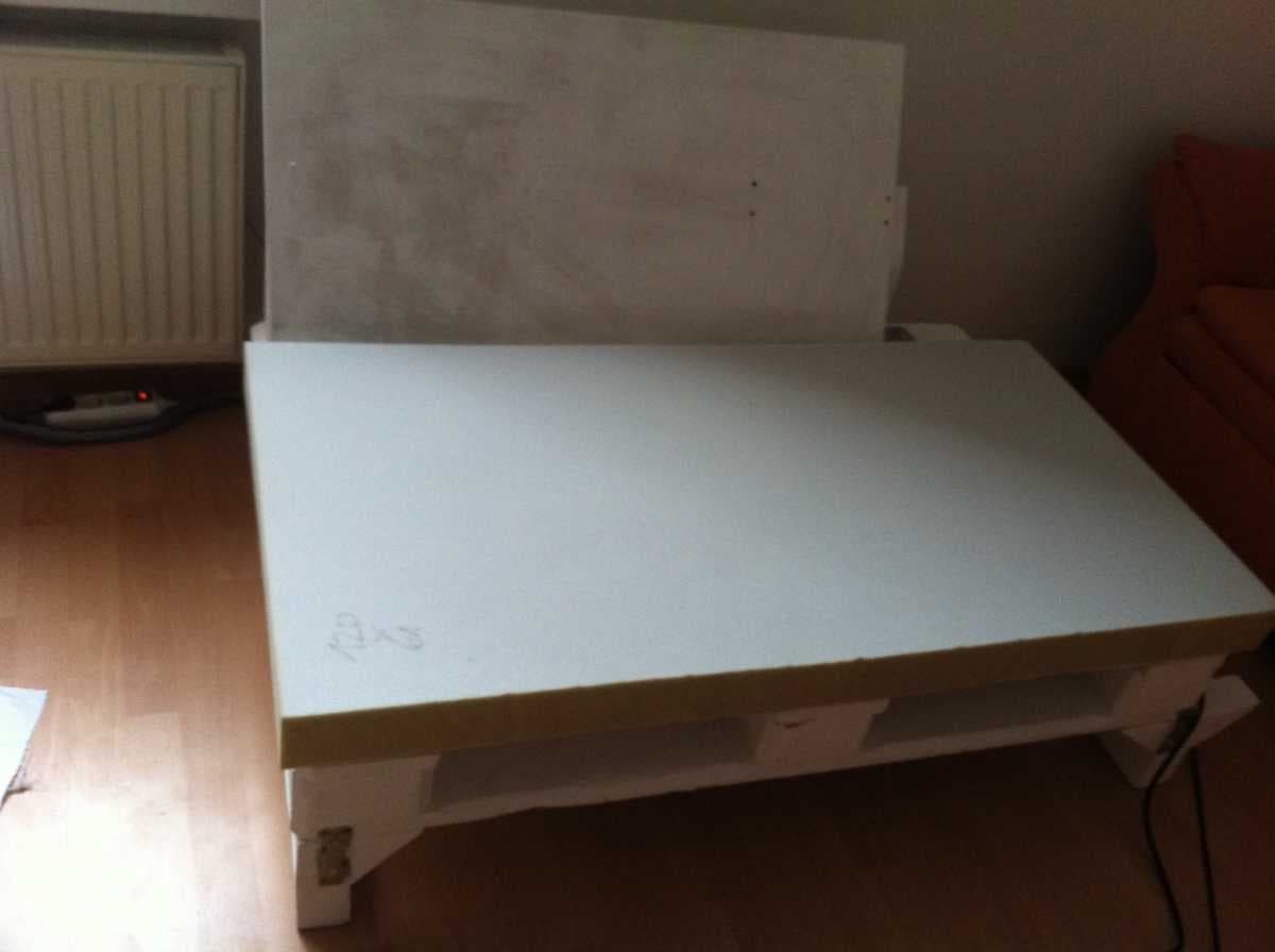Corner sofa DIY assembling: step 10, applying the plywood as the seat