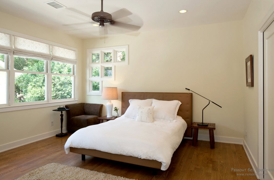 Window Design in the Bedroom for Ultimate Coziness and Comfort. White matte colored walls and the fan in small space with large bed