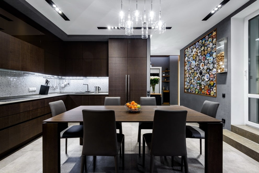 Top 10 most Popular Mistakes when Designing a Kitchen. White ceiling and dark furniture for the modern styled space with dining zone