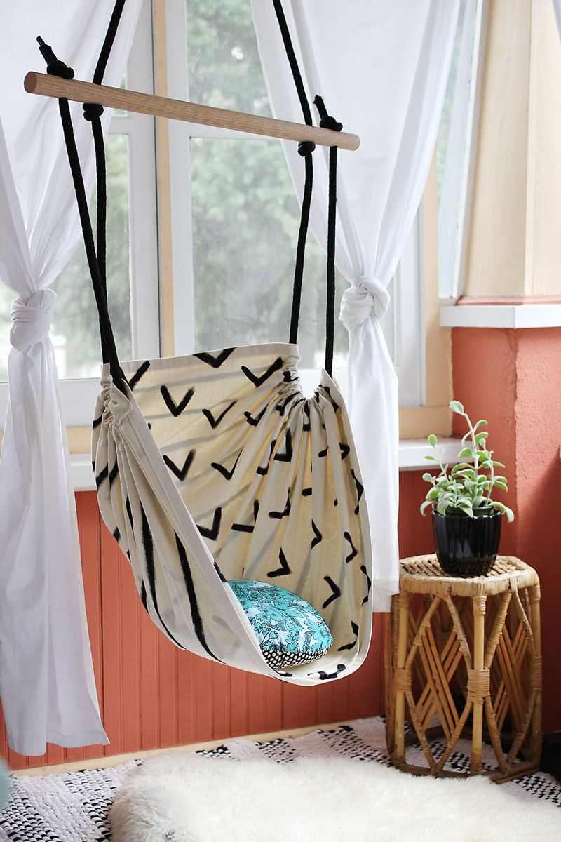 Small curtain hammock with black ropes and pillow