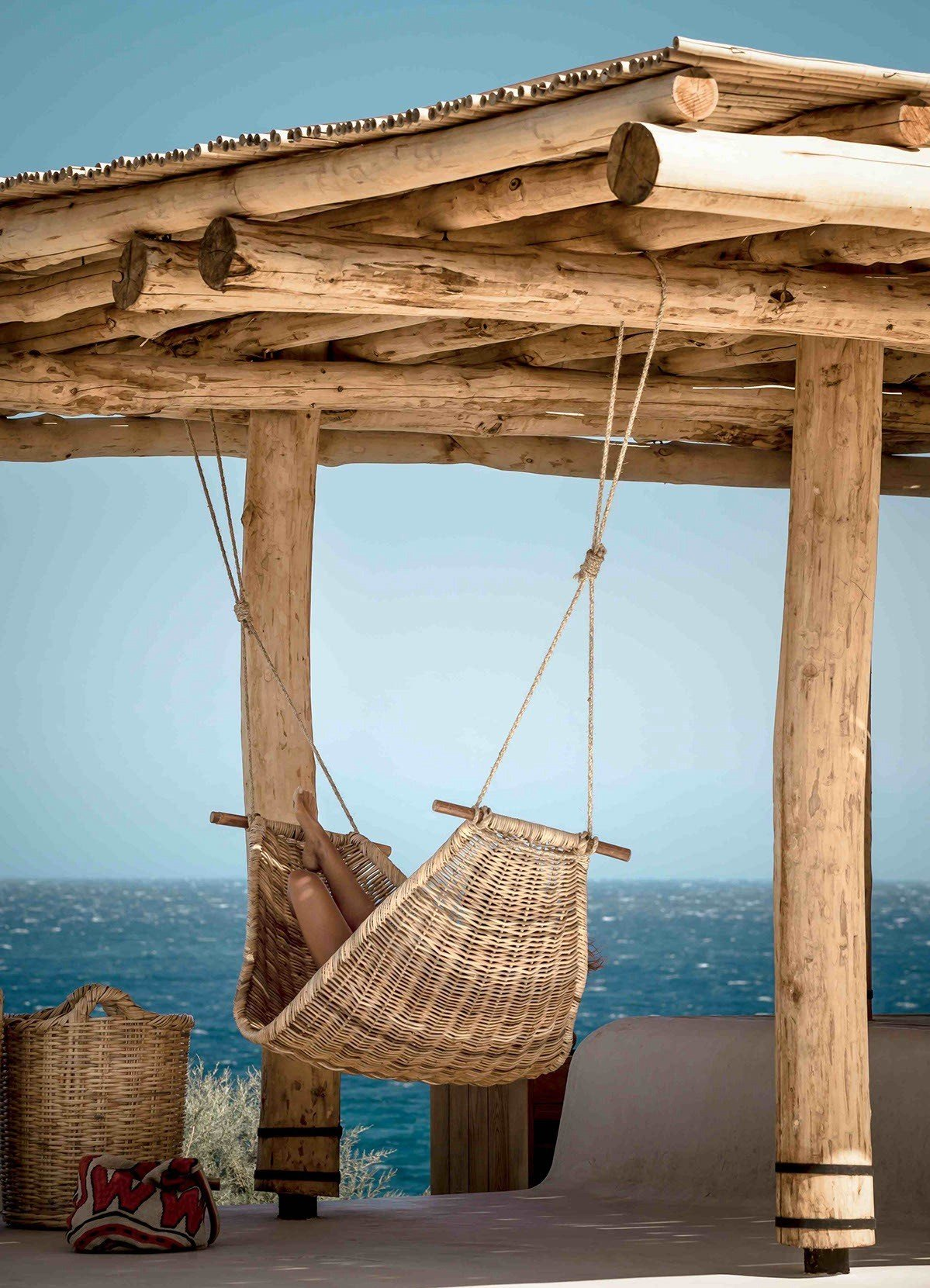 Wooden arbor at the seaside with hammock