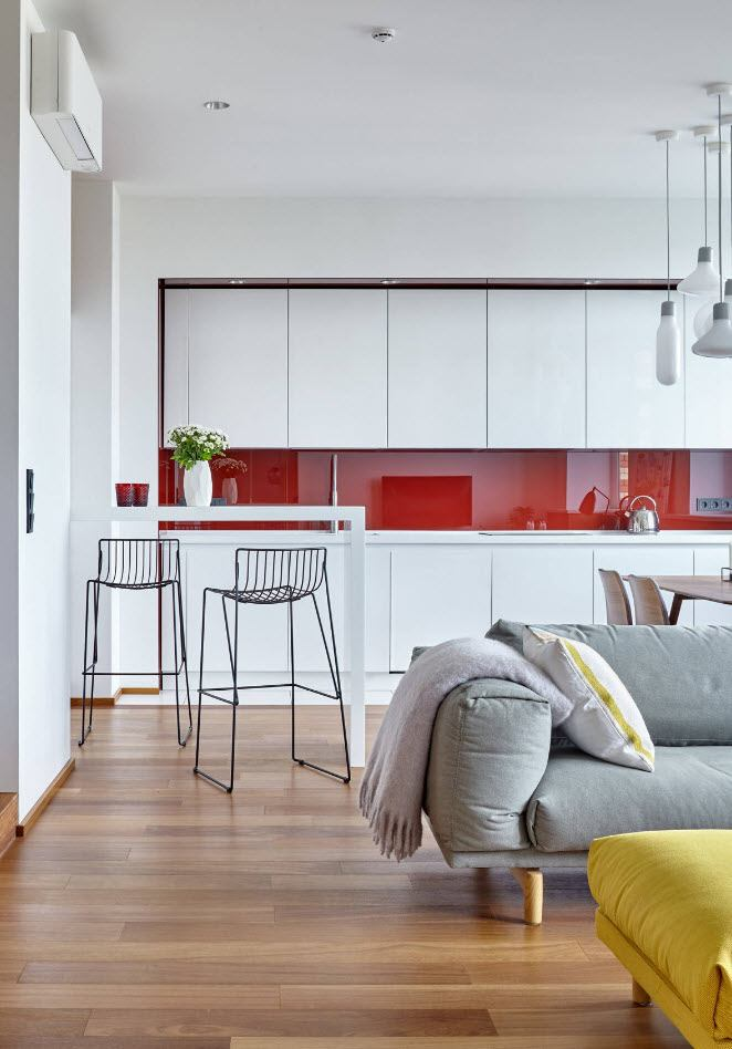 Top 10 most Popular Mistakes when Designing a Kitchen. Red splashback and white smooth kitchen facades for the hi-tech styled interior