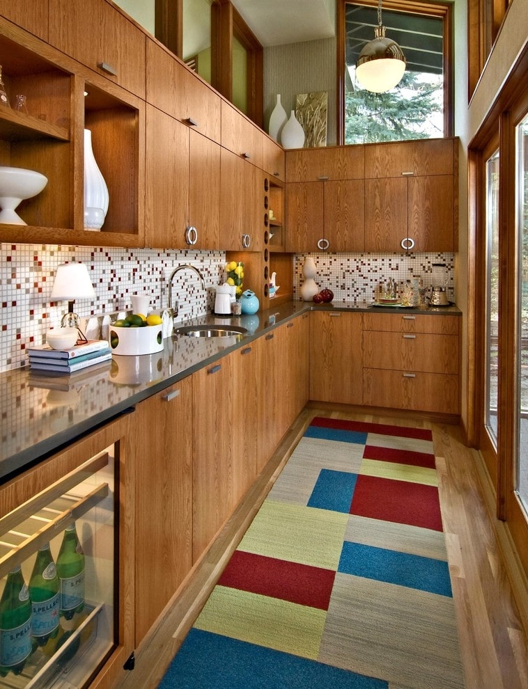 Colorful floor and the wooden colored furniture for the private house's kitchen