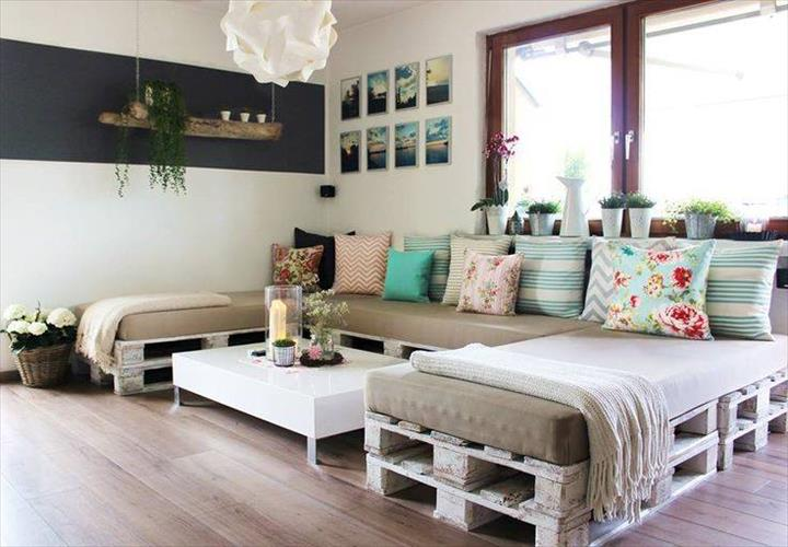 Large c-shaped sofa made of pallets