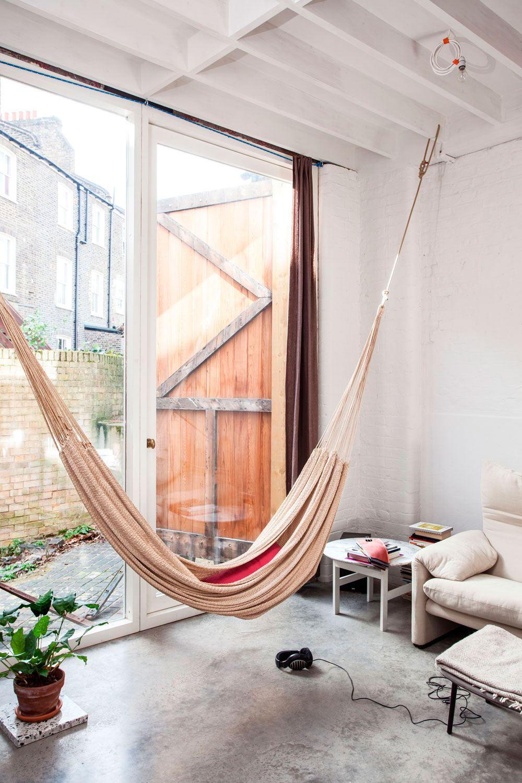 Modern Scandinavian interior in white with hammock