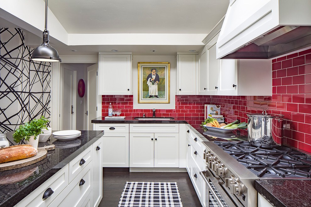 White designed kitchen with red brick imitating splashback and the picture to revive monotonous arrangement