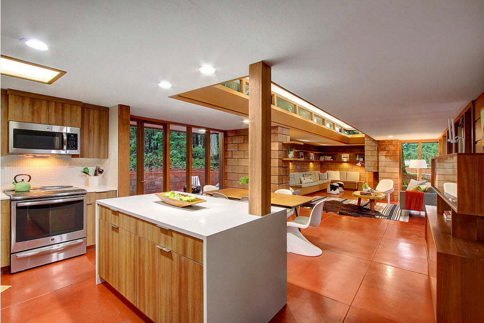 Original Country House Design in Red Color. Kitchen island at the open space cooking area