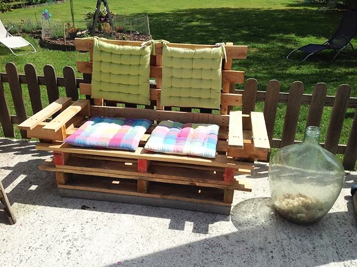 Outdoor sofa made of pallets with soft backrest and seats