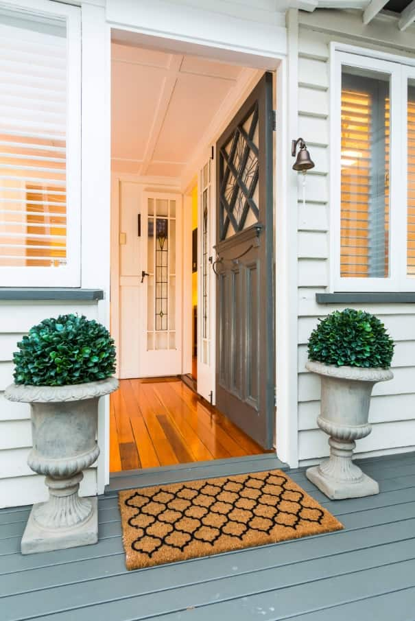 How to Cut the Costs of Moving Home. The entrance to the new house with the floral decoration and white wainsoting of the entrance