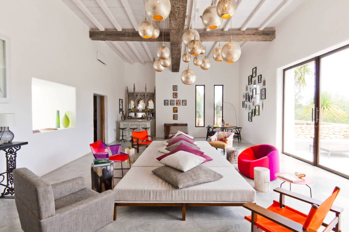 Top Tips for Making Sure Your Home Is Party-Ready. Unusual Mediterranean designed house with the open ceiling beams and decorated lighting