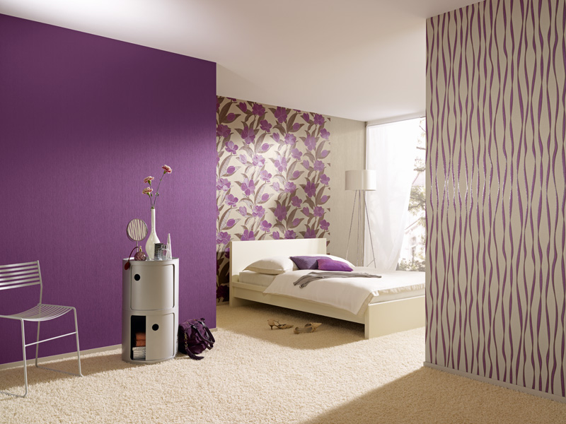 Purple accent wall for light lit bedroom with wallpaper