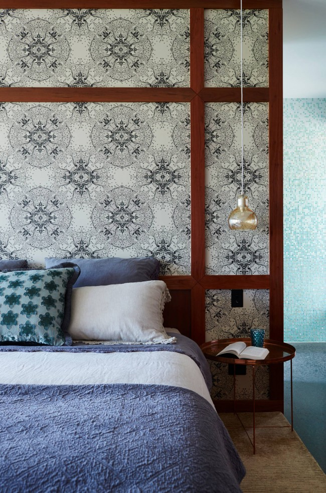 Wooden frame for the bedroom with pattern on the wallpaper